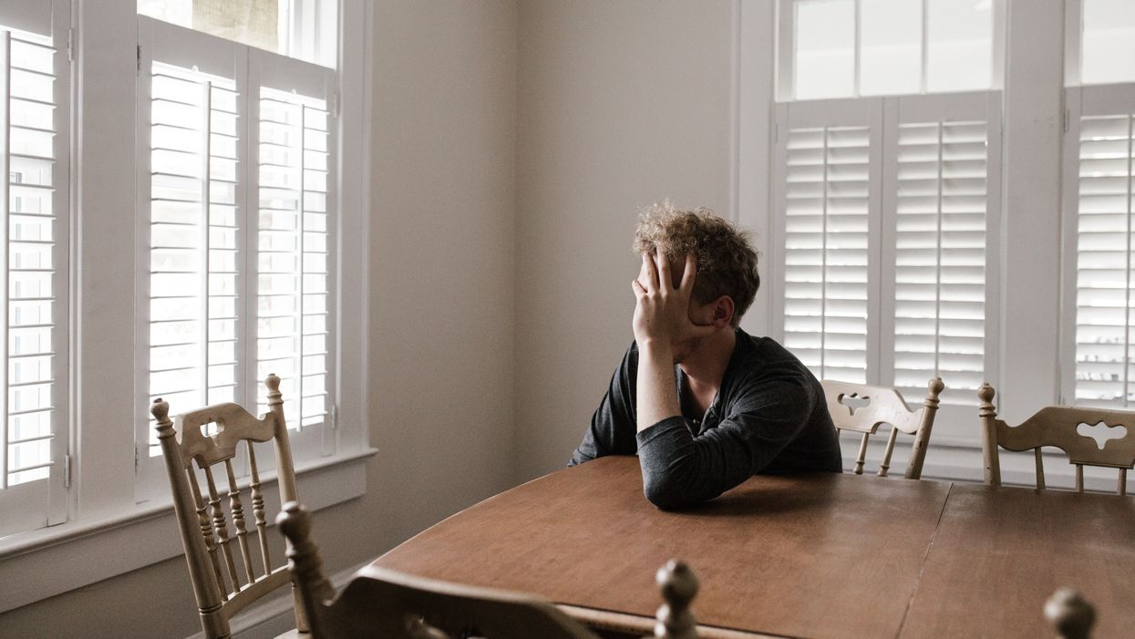 man sitting alone at table