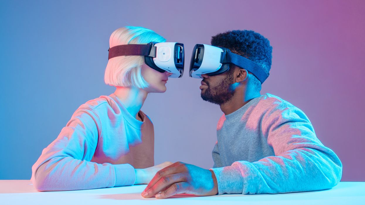 two people face to face wearing VR headsets
