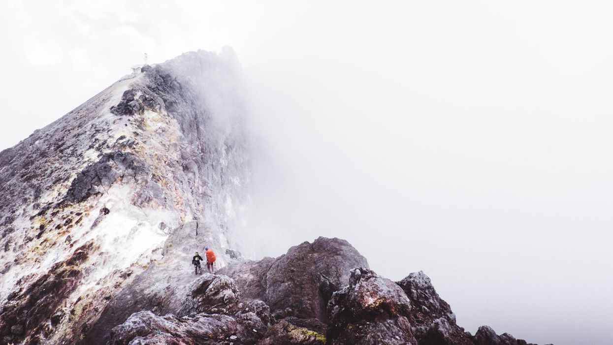 Two hikers climbing a mountain, illustrating Nietzsche's affirmative philosophy.
