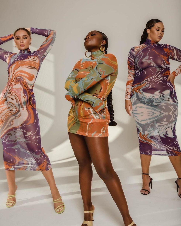 Models wearing Gaia dress in purple and orange, green and orange