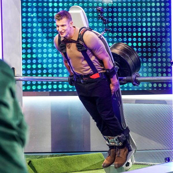 Gronk is strapped into a giant foosball game to serve as goalie