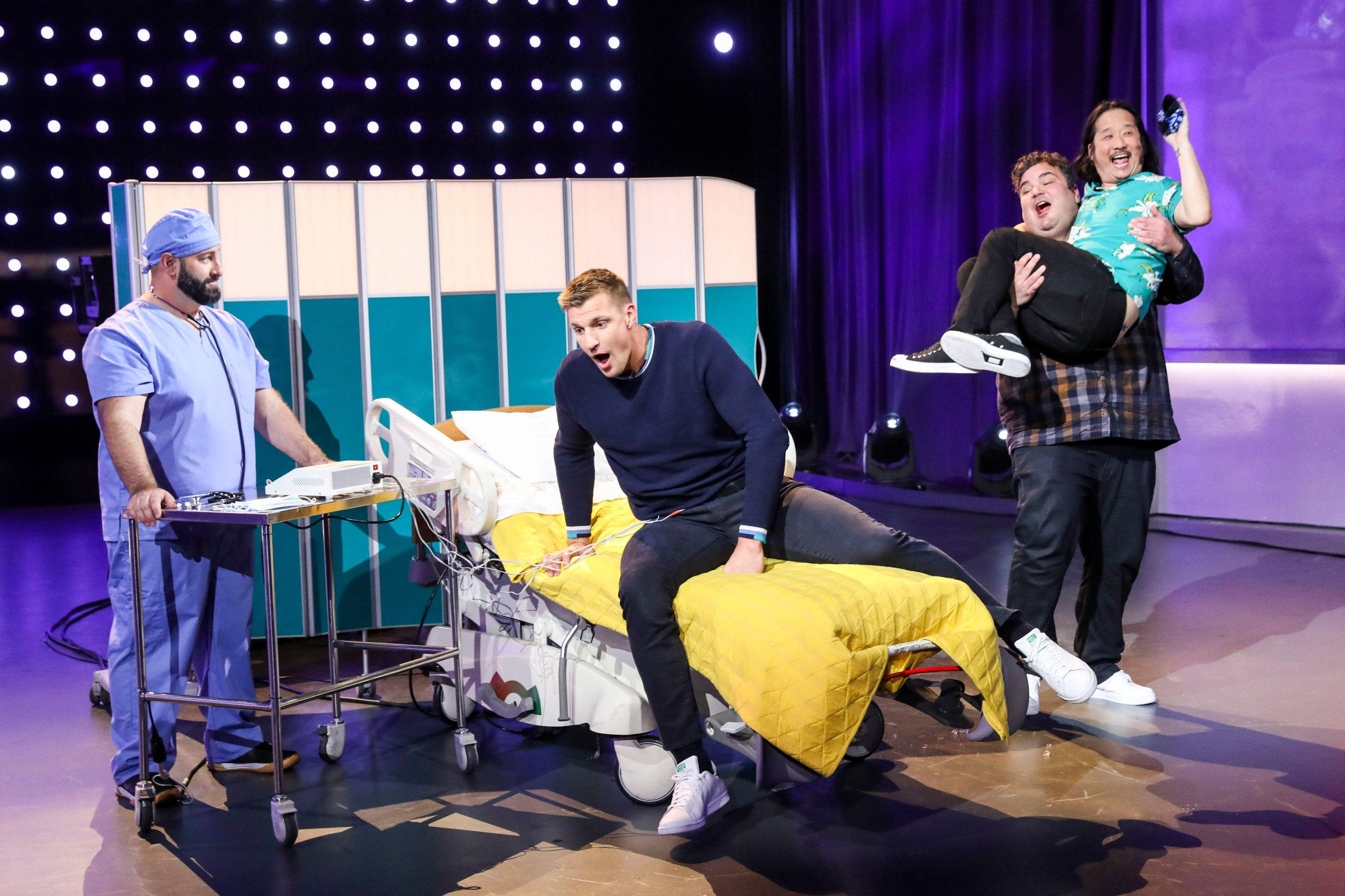 Gronk experiences simulated labor pains with the help of a birthing simulator attached to his abdomen
