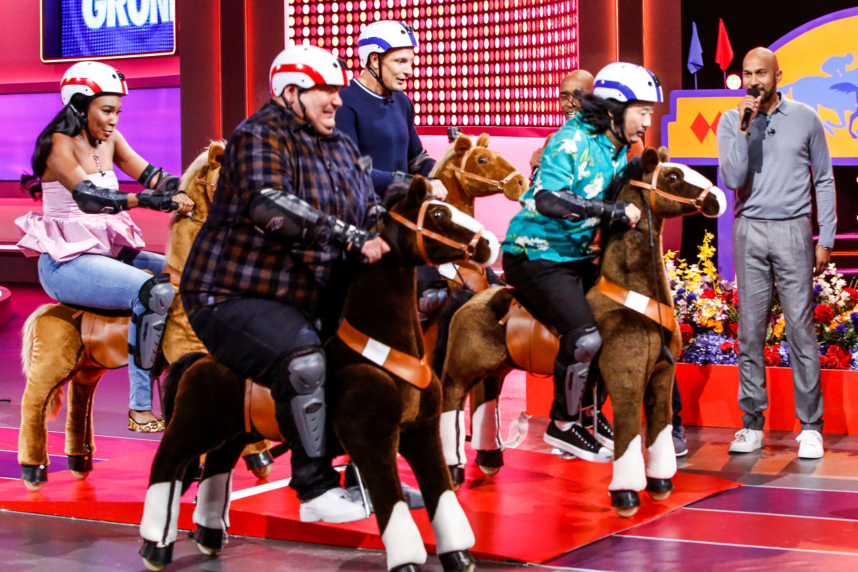 Gronk and the Game On regulars race plush mechanical horses around the set