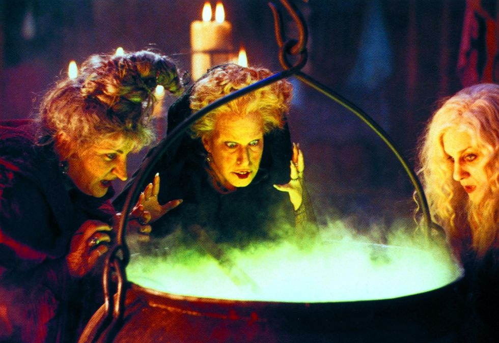 three witches from Hocus Pocus staring in to a cauldron