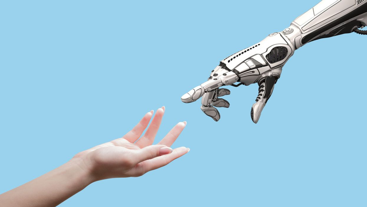 human and robot reaching out hands to each other