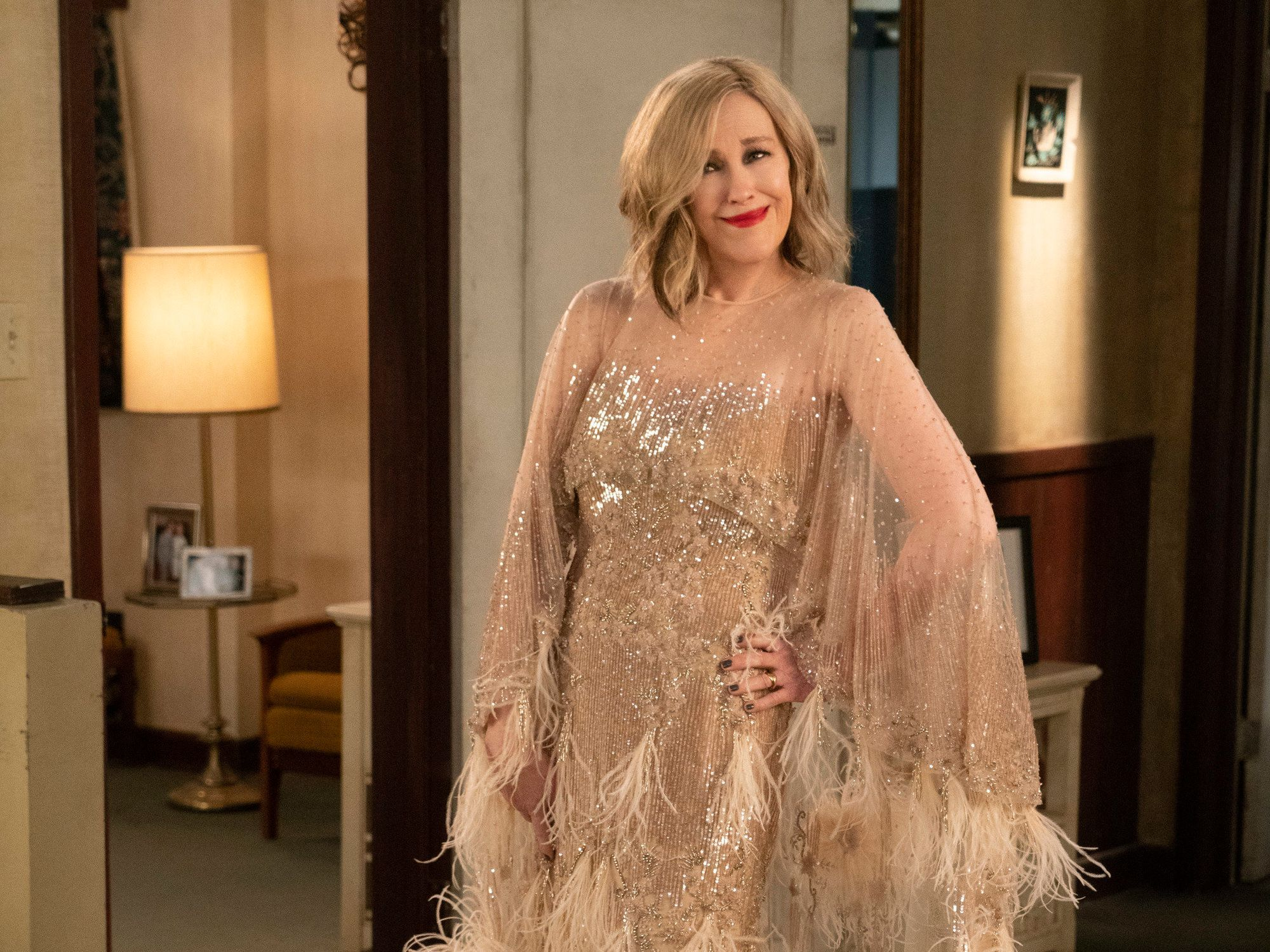 Moira models the glamorous sequined gown she bought for her movie premiere
