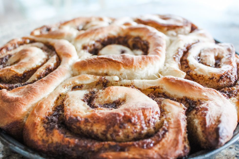 close-up of cinnamon rolls on a grey plate