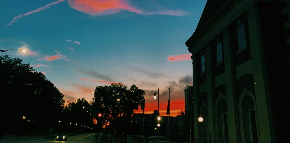 Sunset pictured behind entrance to the church that is connected to Newman Hall, the Catholic dorm that is discussed in this article.