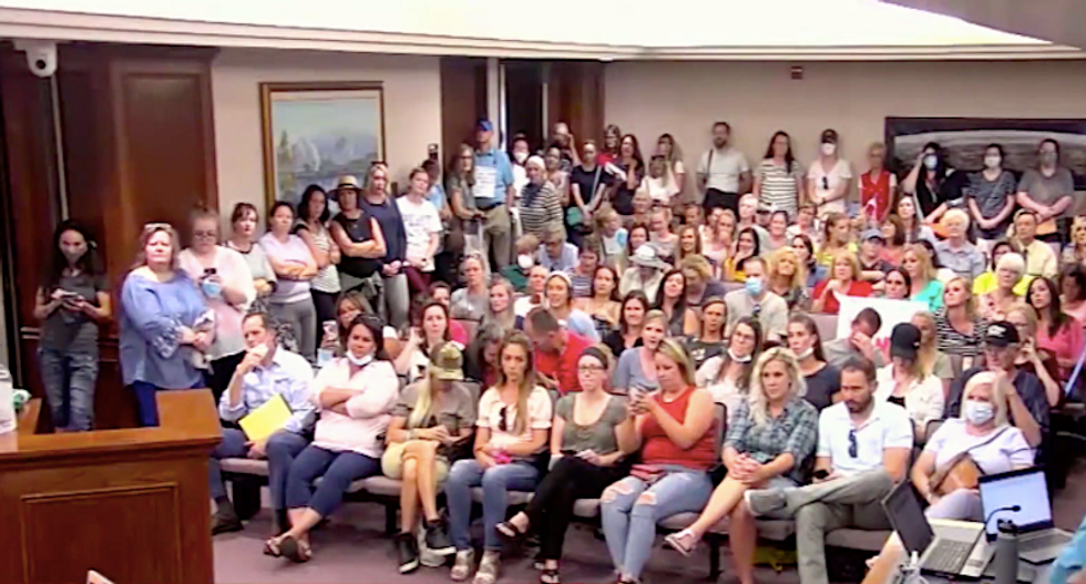 'Jesus gives us a choice!' Utah public meeting goes off the rails as Trump fans denounce mask order