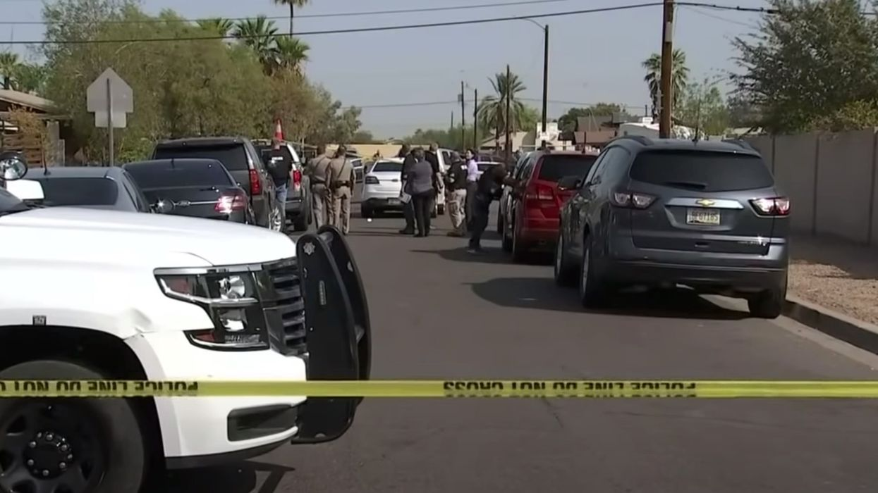 Car pulls up to troopers and teen passenger shoots at them in Phoenix ambush; one arrested, police on manhunt for driver