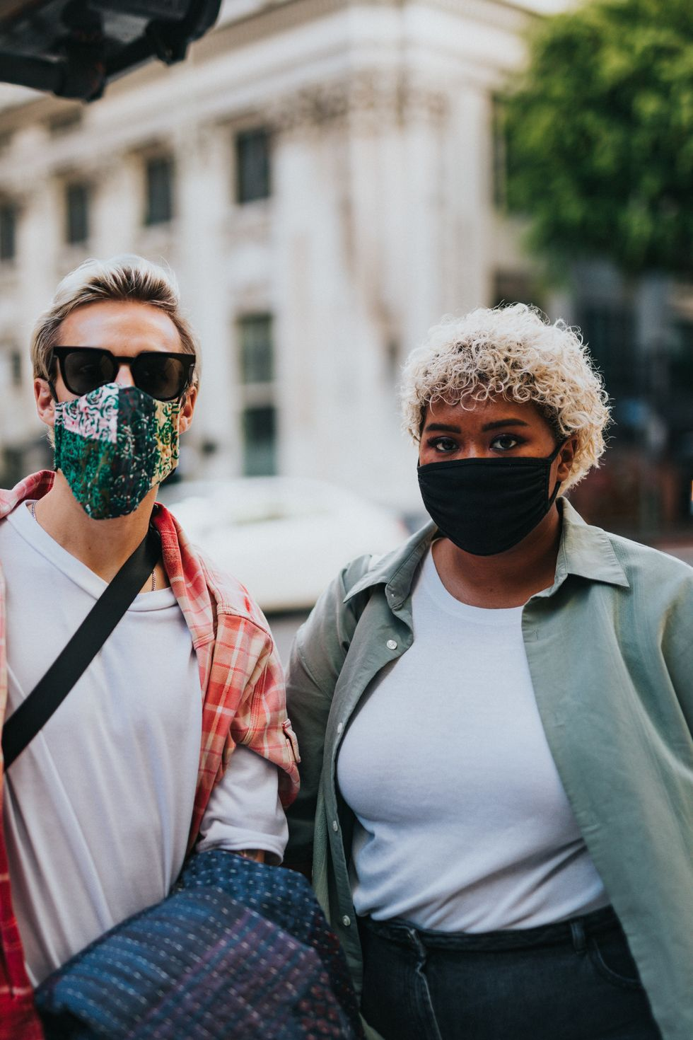 two young adults wearing masks