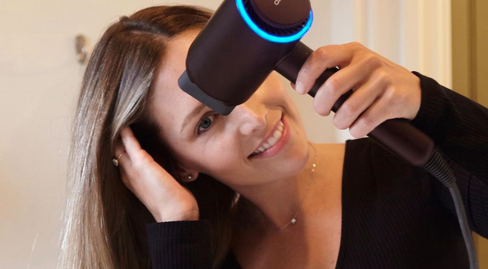 This Hair Dryer Straightens My Wavy Hair In Under 10 Minutes — And It's Half The Price Of A Dyson