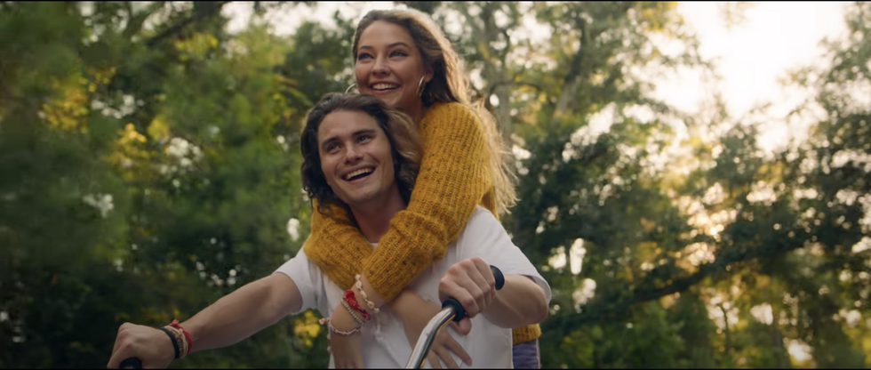 "Chase Stokes and Madelyn Cline on a bike in Kygo's new music video for ""Hot Stuff"""