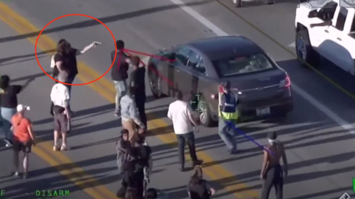 Man loses his job after pulling a gun on protesters in Louisville. Police posted video showing a protester pointing a gun at him.