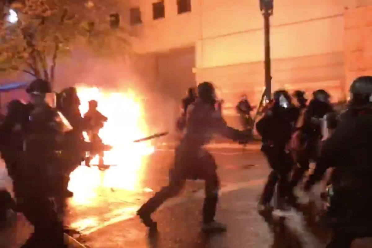 Rioter throws Molotov cocktail at group of Portland police officers, striking one, as mob sets fire to justice center following Breonna Taylor indictment