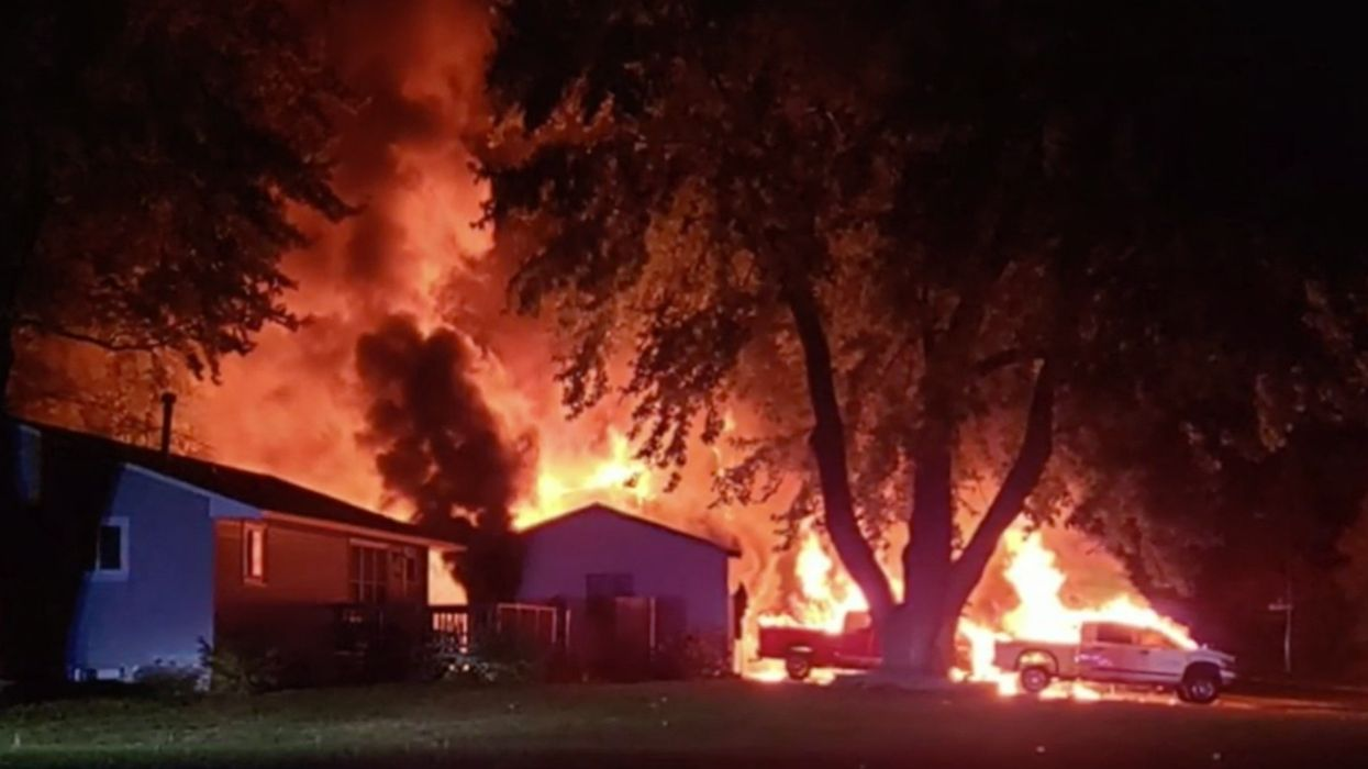 Suspected arson levels Trump supporter's garage, vehicles. Graffiti at the scene reads 'Biden 2020,' 'BLM.'