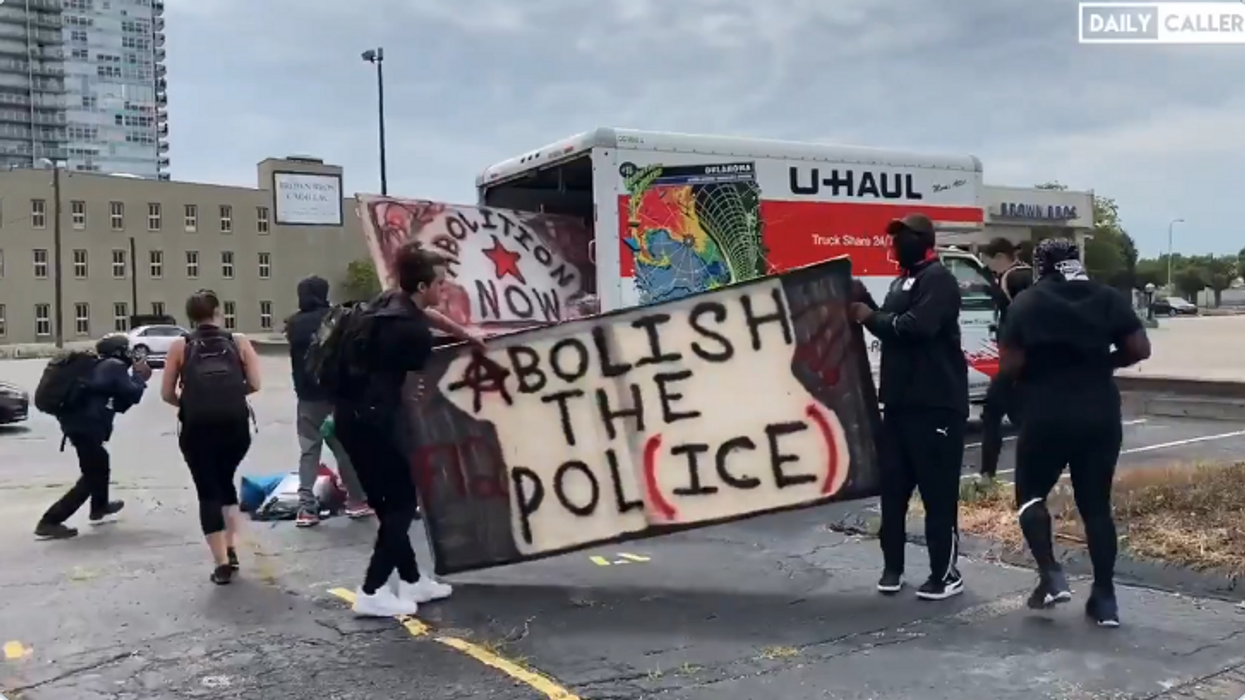 VIDEO: Parked U-Haul truck distributes riot shields, signs, other supplies to BLM protesters in Louisville