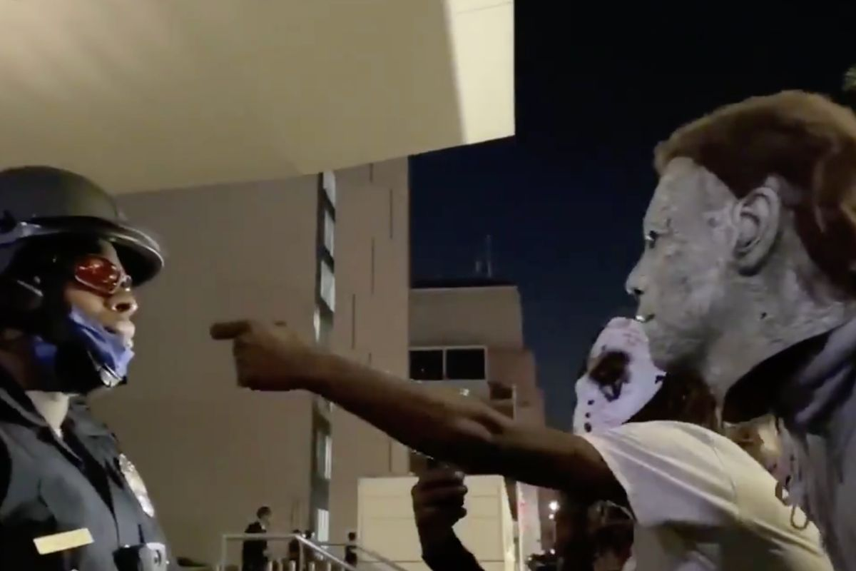 Rioters scream racial slurs at black police officer during Breonna Taylor protests. His stoic response is everything.