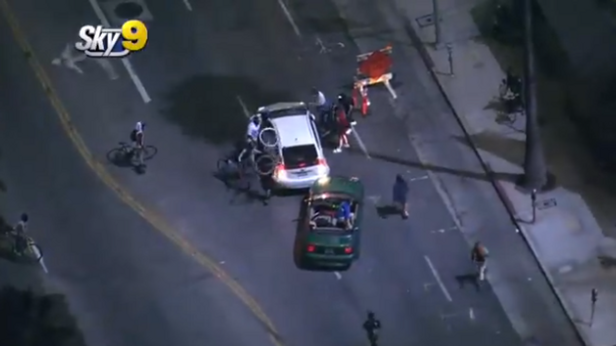 Man drives through protest in a Prius, gets chased down by cars and attacked by protesters