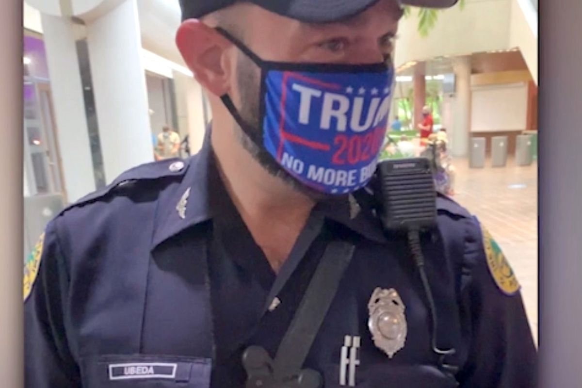 Miami police officer will be disciplined after wearing a 2020 Trump face mask at voting site while in uniform