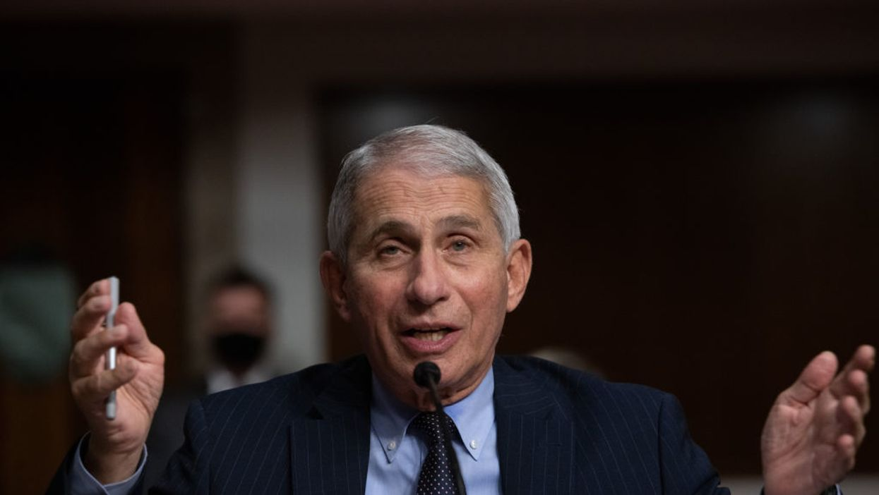 Dr. Fauci says even with a vaccine, masks and social distancing will continue until 2022