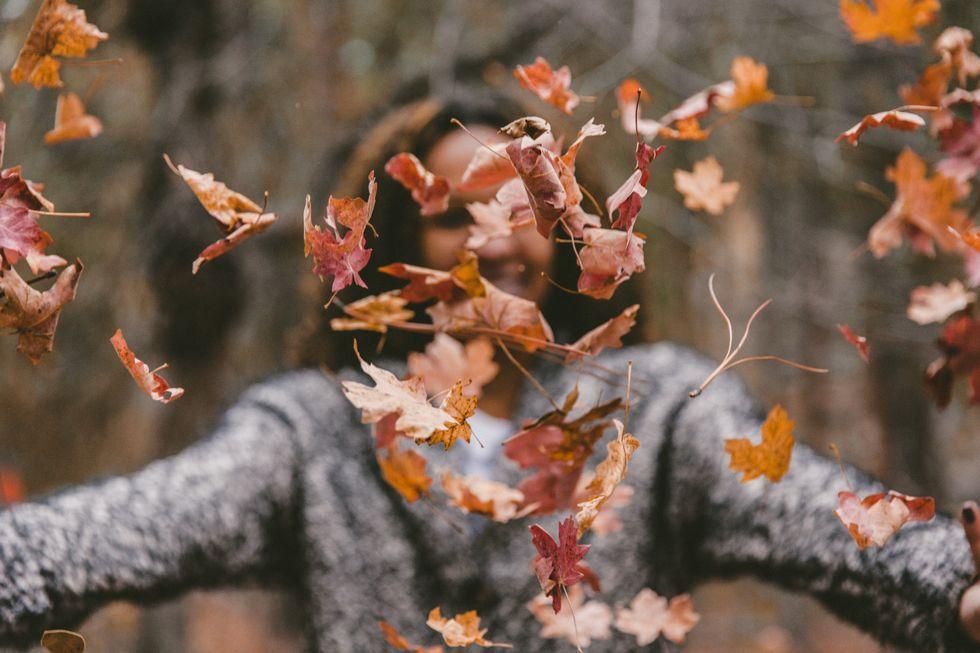women throwing leaves