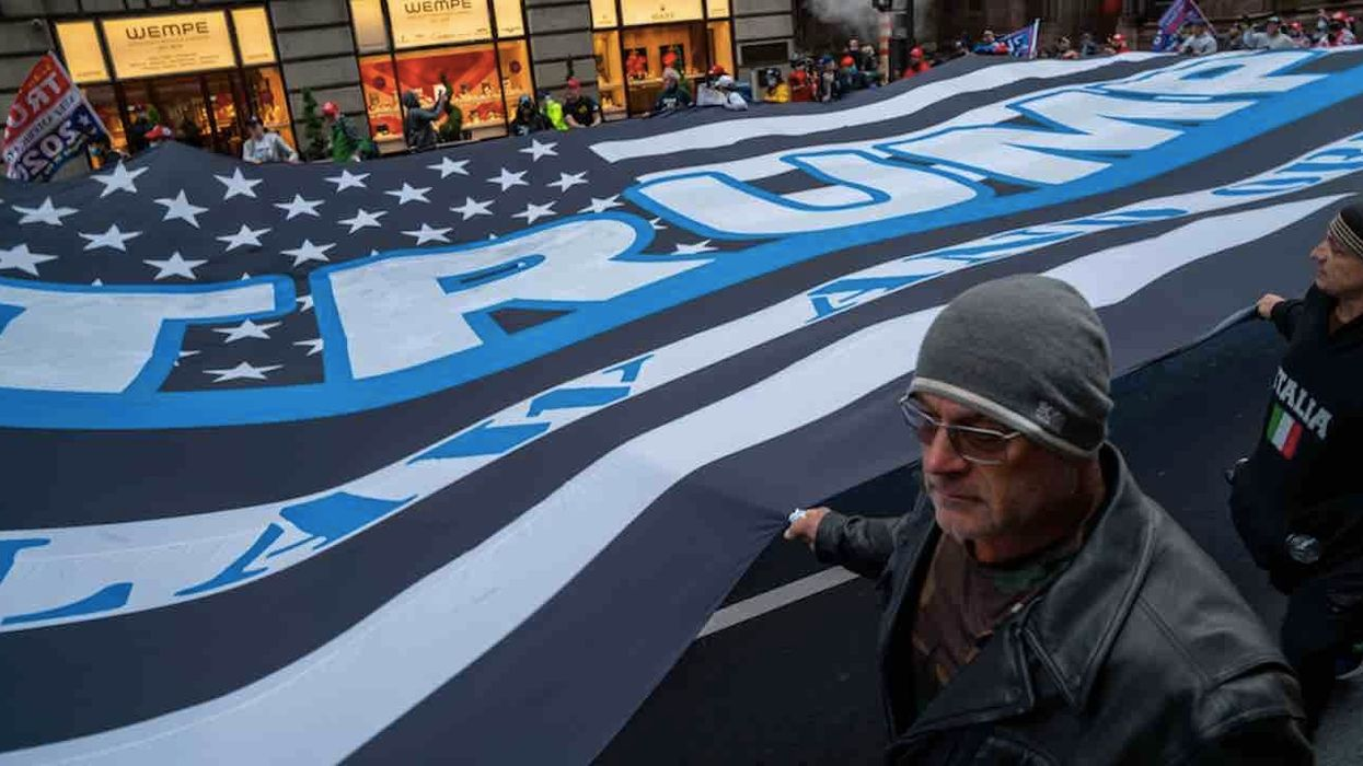 Huge Trump flag unfurled over Black Lives Matter mural on NYC street in front of Trump Tower and paraded around city