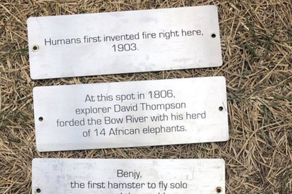 Someone placed funny, fake historic plaques on park benches around this Canadian city