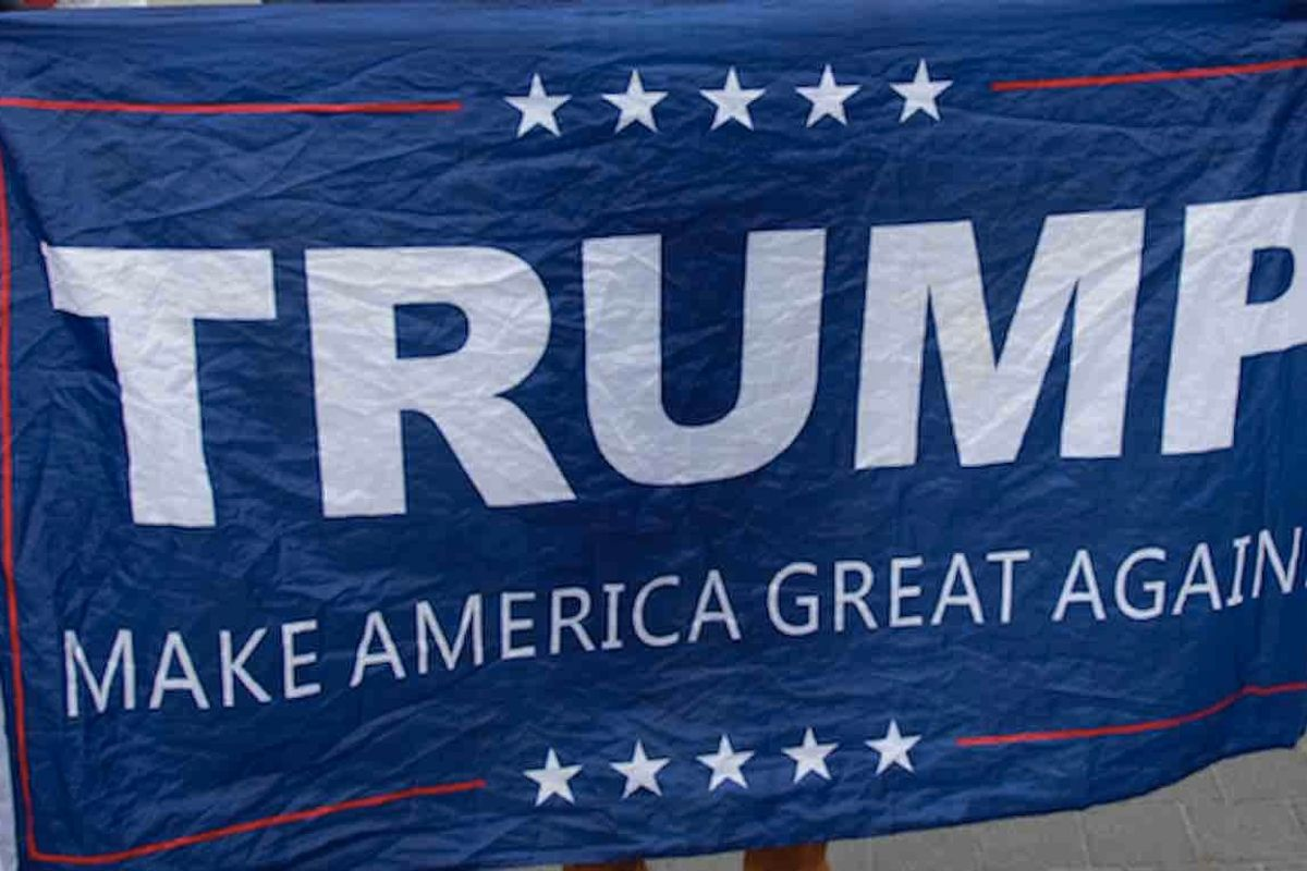 Man, 60, tells cops he burned Trump flag hanging from home during paper route because he was 'angry'