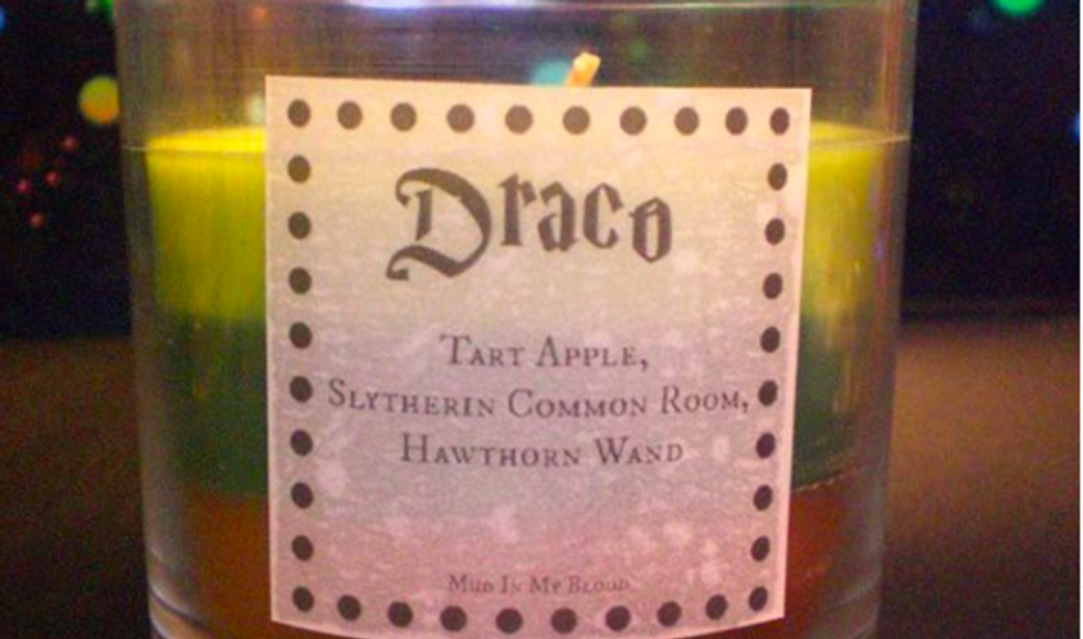 "green candle with ""draco"" written on label"
