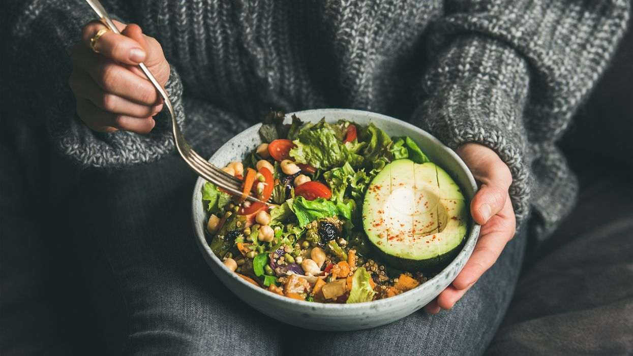 person holding bowl of salad