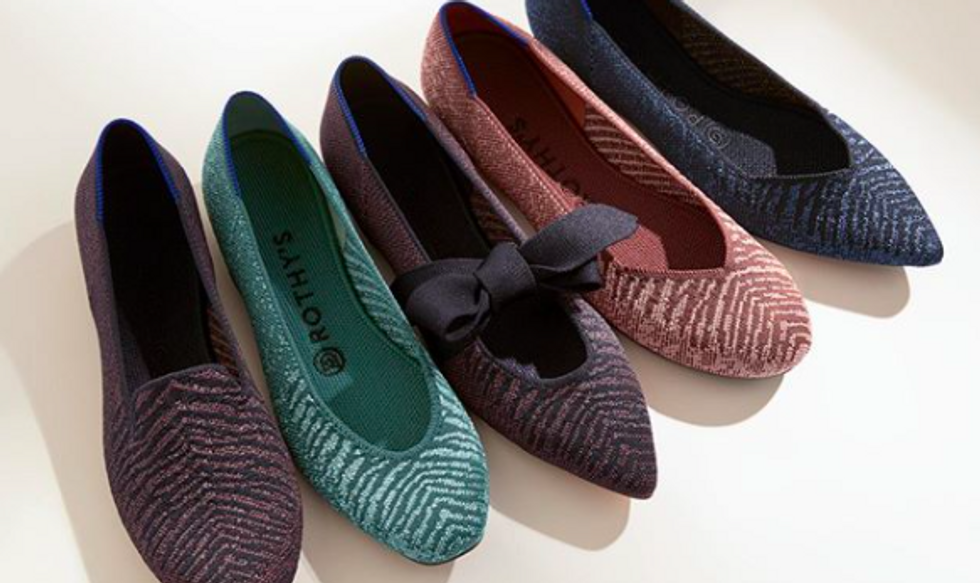 different colored shoes and flats lined up on a white floor