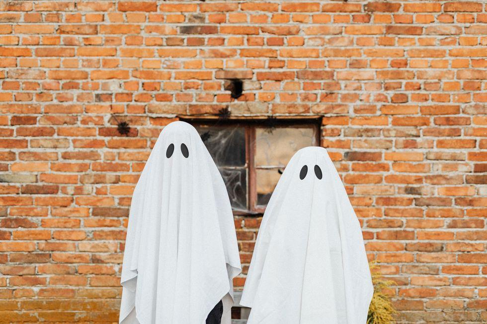people dressed up as ghosts