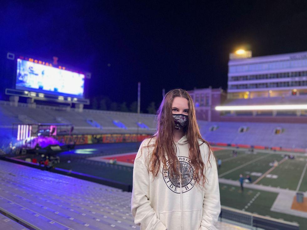 woman wears mask in a stadium
