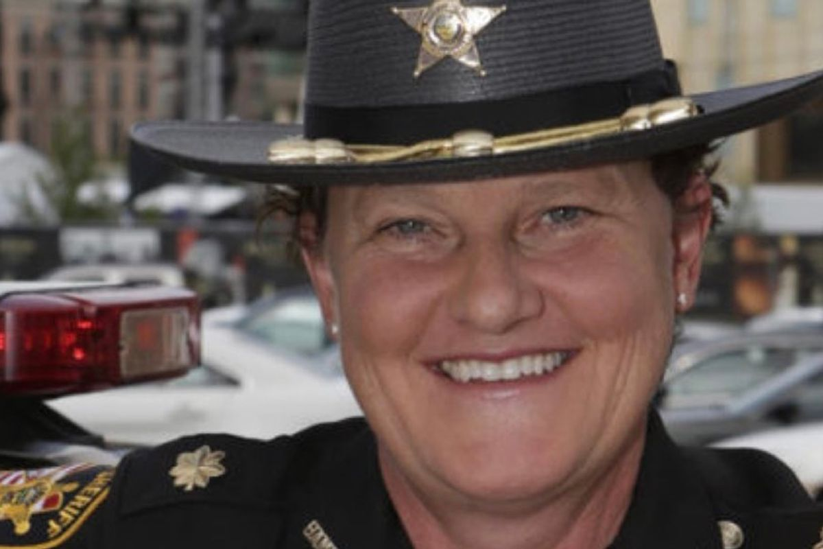 She was fired by the sheriff for being a lesbian. So, she ran for his job and beat him.