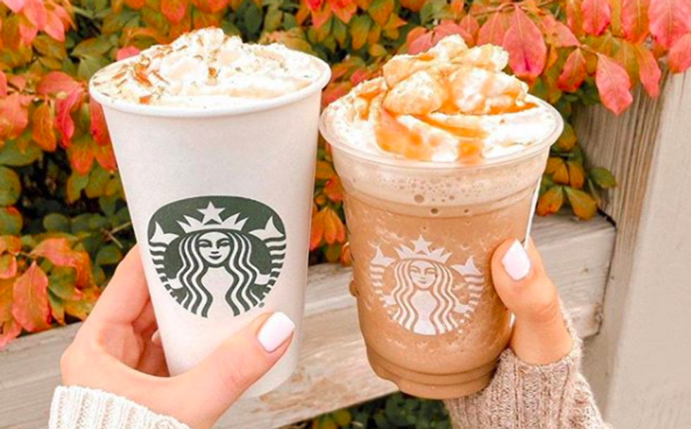 one hot and cold starbucks drink next to each other with red leaves in the background