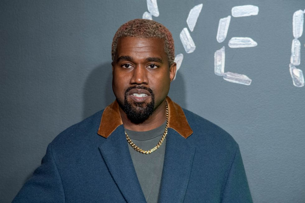 Kanye West Pictured With Entire Body Painted Silver
