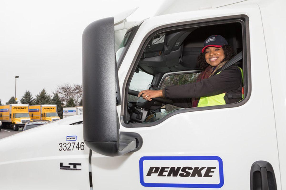 Woman in Penske truck