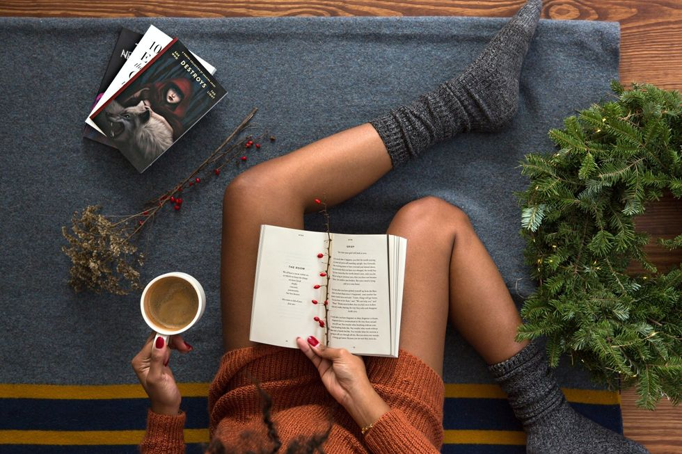 Girl reading with a warm drink