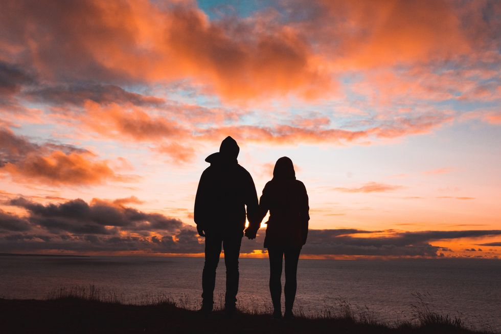 Couple looking at sunset.