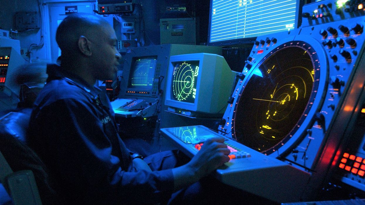 An air traffic controller works for the US Navy in 2002.