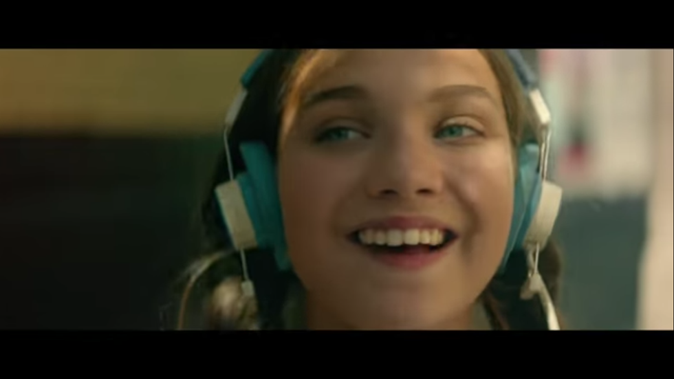 Maddie Ziegler is shown in the trailer wearing blue and white headphones