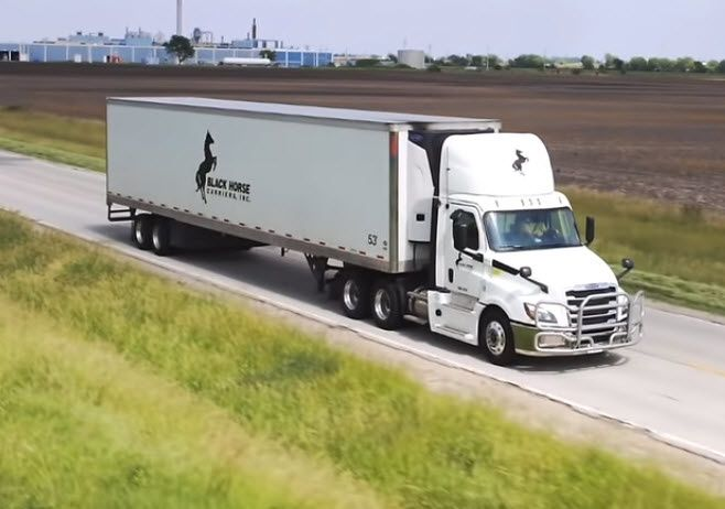 Black Horse Truck Leasing truck on the road