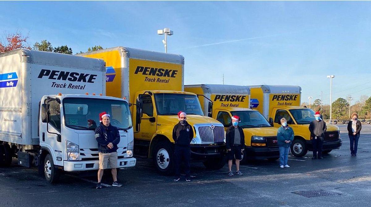 Penske trucks with Santa's helpers