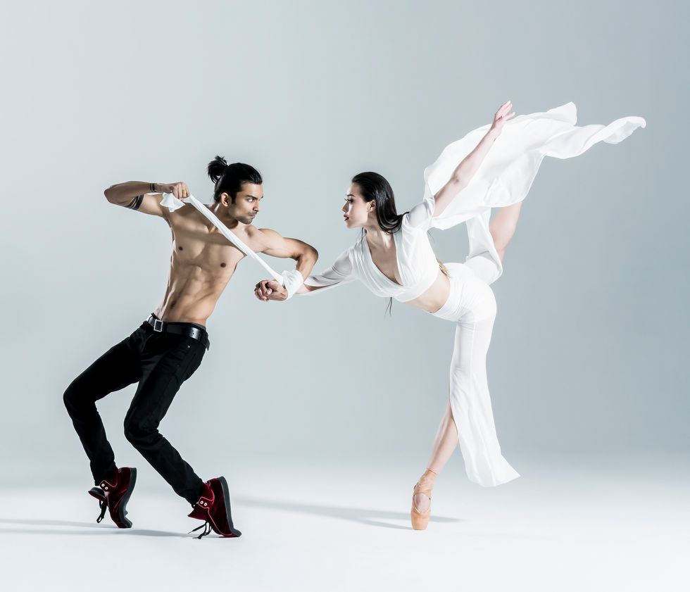 A male dancer (shirtless in black pants and sneakers) pli\u00e9s while balancing on his toes. She became a household name virtually overnight as a two-time professional champion on ABC's top-rated