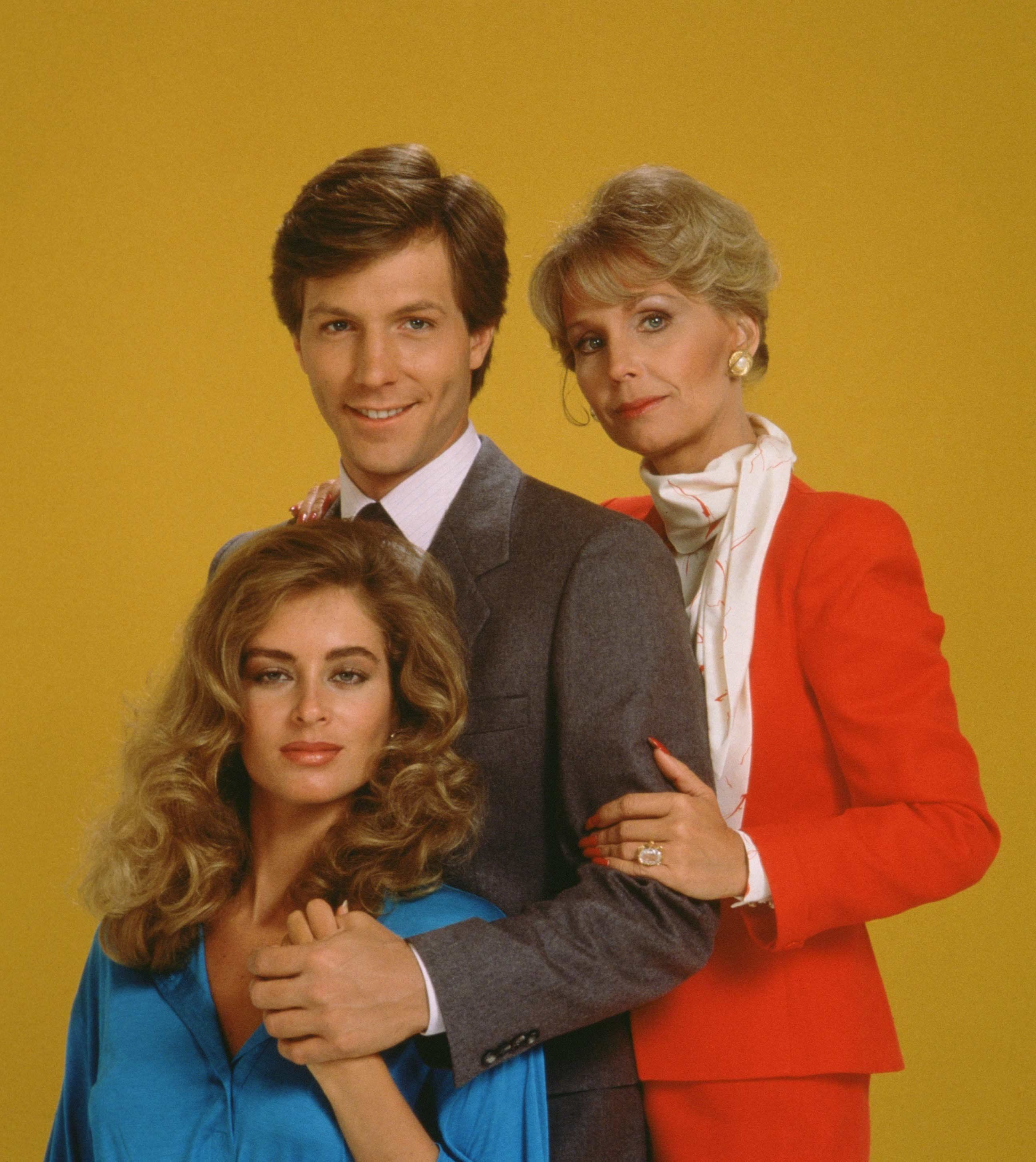 Eileen Davidson as \u200bAshley Abbott with Brian Matthews as Eric Garrison and Marla Adams as Dina Abbott
