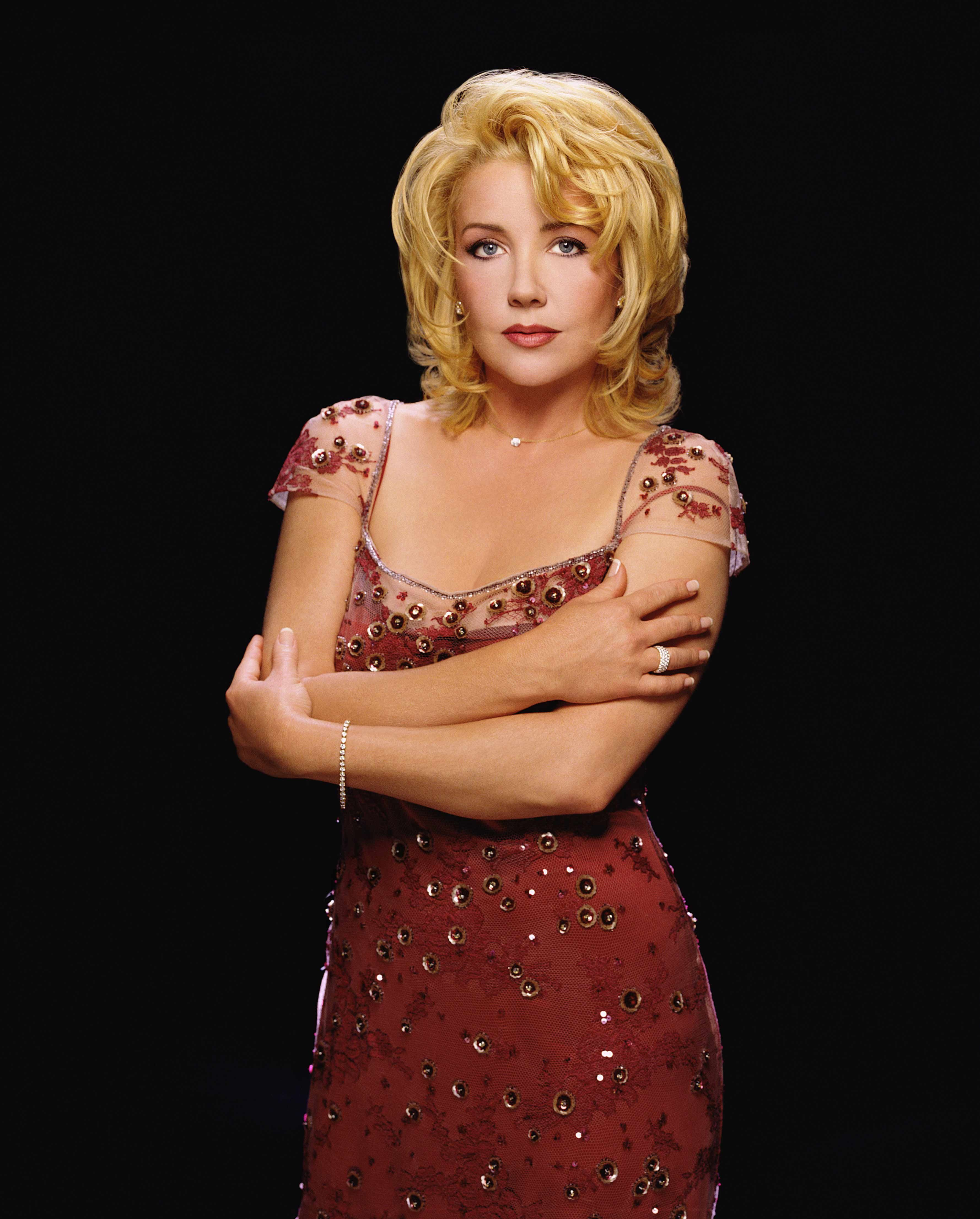 Melody Thomas Scott as Nikki Reed Newman in a red dress