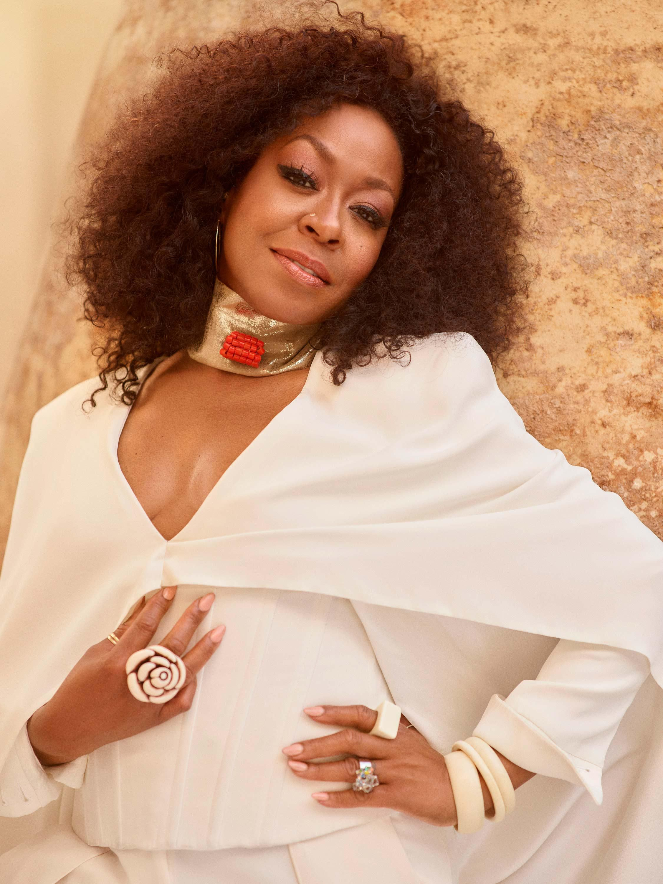 Tichina Arnold in a white gown and matching jewelry