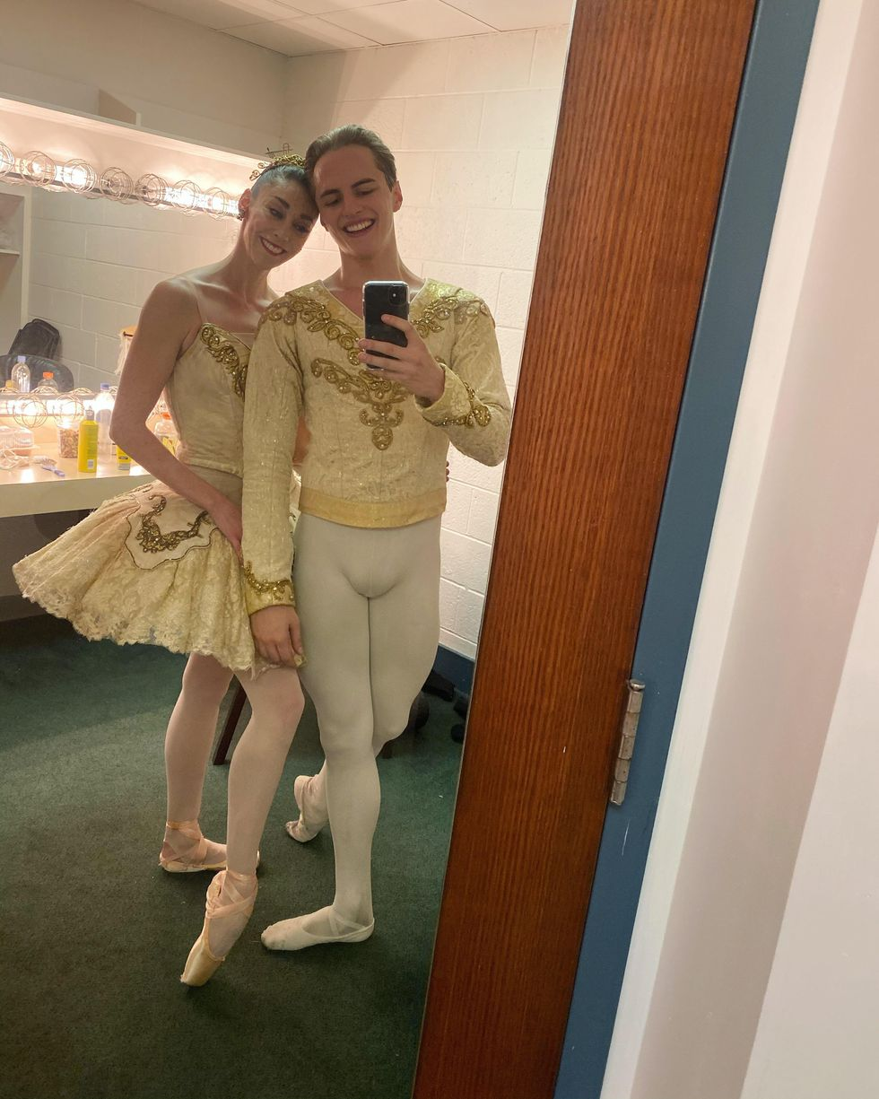 A male and female dancer stands next to each other closely and pose for a selfie in a green-carpeted dressing room. Recently I spoke with some of my fellow PNB dancers about why losing our <em>Nut</em> guestings is such a blow.</p>, <img lazy-loadable=