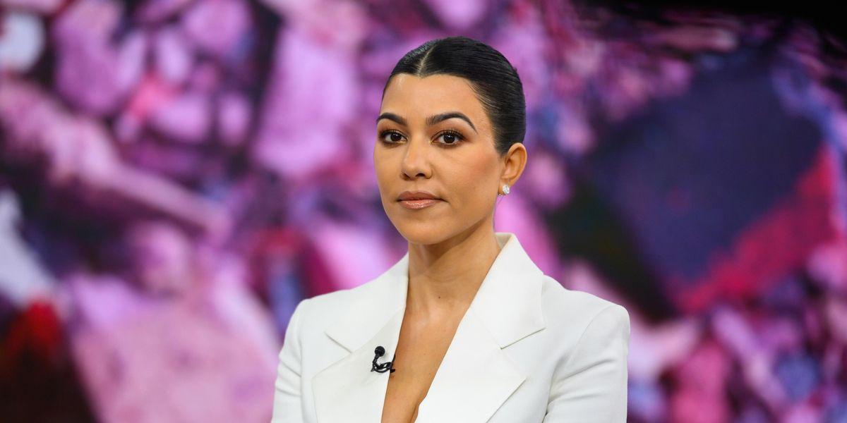 Fans Think Kourtney Kardashian Was Photoshopped Into a Family Holiday Photo